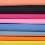 Tissu coton jaune 025, orange 026, gris 014, lavande 022, rose 006, fushia 007, noir 009 et pêche 035