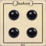 Bouton demi boule noire pour couture de chemisier