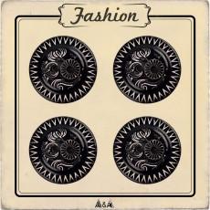Bouton noir et blanc avec arabesques