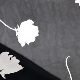 Tissu voile noir à fleurs blanches