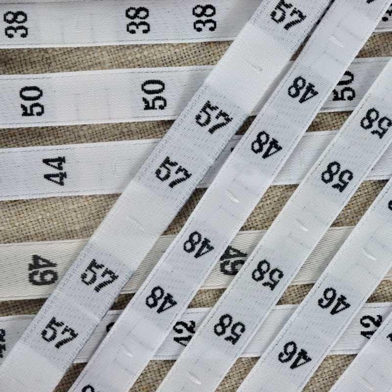 Rouleau 25 m tiquettes num rot es a a patrons - Triangle sur etiquette vetement ...