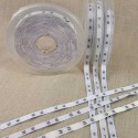 Rouleaux 25 m étiquettes de taille adulte en lettres de XS à XXL