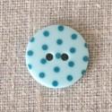 Bouton à pois bleu turquoise
