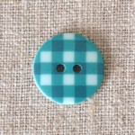Bouton à carreaux bleu