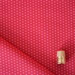 Cotonnade à pois rose sur fond rouge framboise Froufrou