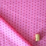 Cotonnade à étoiles rouge framboise sur rose Froufrou