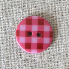 Bouton à carreaux rose