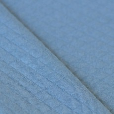 Tissu jersey matelassé bleu clair en 100% coton bio