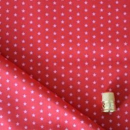 Cotonnade à étoiles rose clair sur fond rouge framboise Froufrou