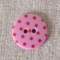 Bouton à pois rose
