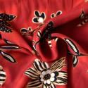 Tissu fleurs noires et ocre fond rouge