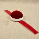 Bracelet pelote à épingles à fermeture autoagrippante