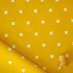 Tissu coton à motif croix moutarde