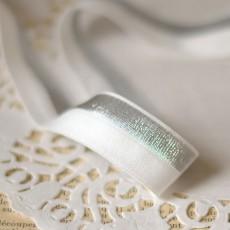 Biais élastique brillant argent sur blanc pour lingerie
