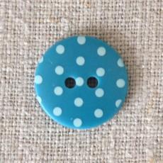 Bouton à pois bleu