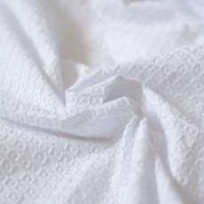 Tissu broderie anglaise en coton blanc au mètre
