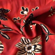 Tissus grandes fleurs noir sur fond rouge