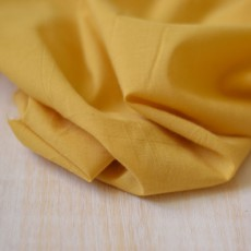 Tissu au mètre voile de coton jaune moutarde