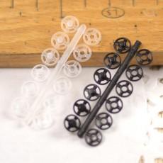 Bouton-pression plastique noir et transparent