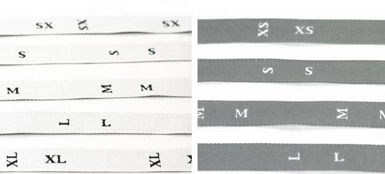 étiquette de taille à coudre blanche et grises